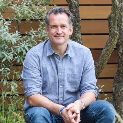 Matthew Wilson sitting in his garden